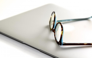 image of spectacles on a laptop
