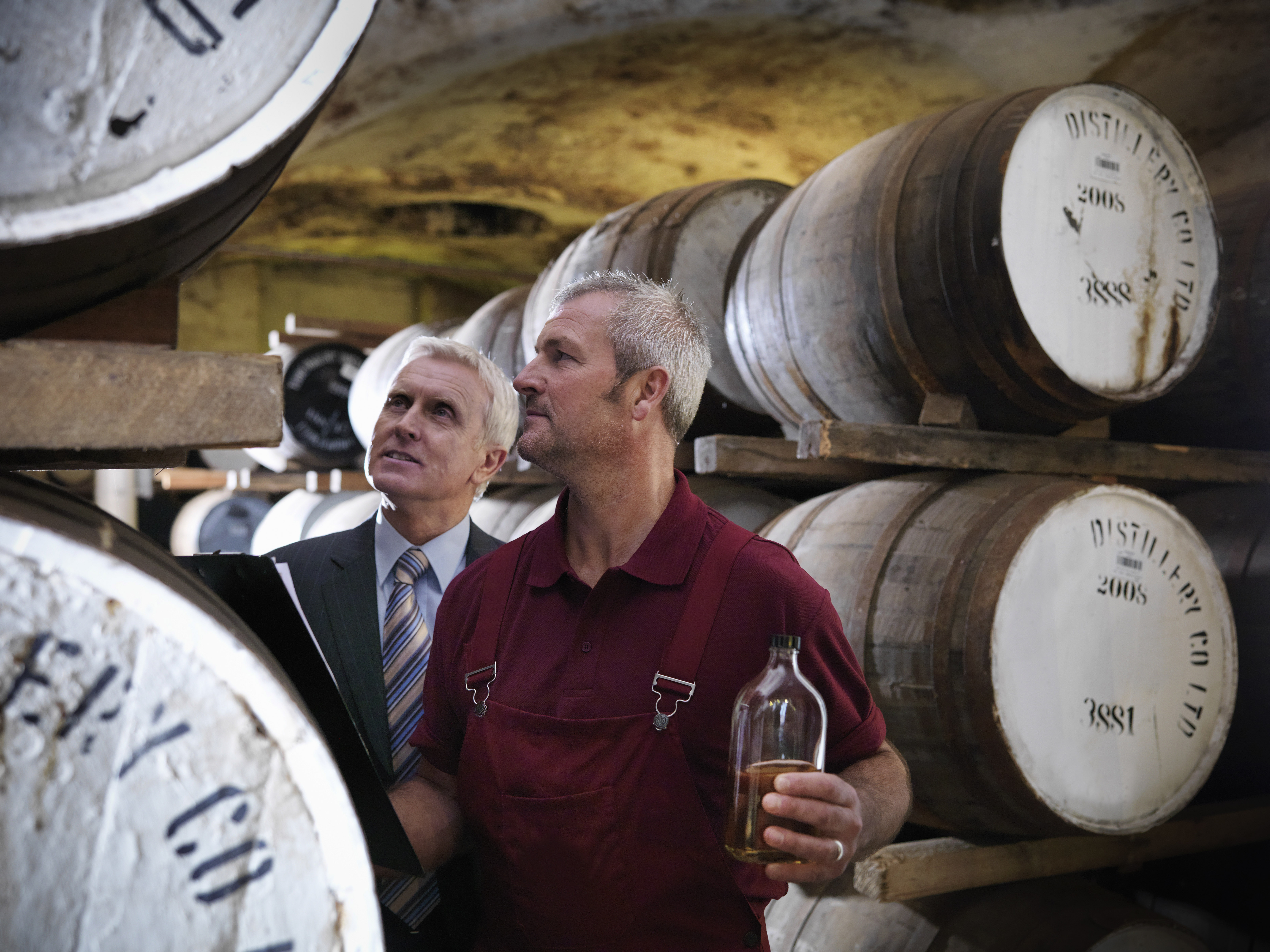 Image showing workers checking whisky in distillery - demand for Business ByDesign is growing in small and mid-sized businesses